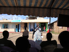 Photo: Aug - 20 - Outreach . This is a Mama who sells fish talking about how she used Eco-Pesa