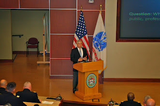Photo: Doug Tystad, CEO, CGSC Foundation, provides opening remarks for the 2014 Fort Leavenworth Ethics Symposium. The Foundation was the CGSC cohost for the symposium.
