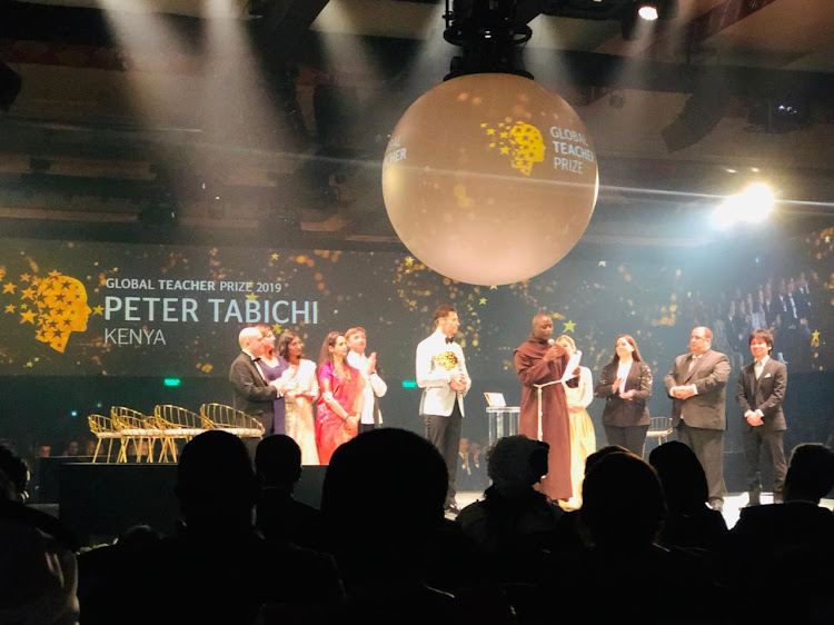 Peter Tabichi and other contestants during the announcement of the Global Teachers Prize winner in Dubai on Sunday, March 24, 2019.