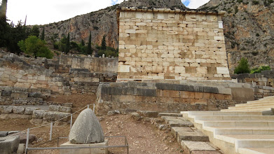 Photo: Foreground: Delphi was considered the center of the world, and this cone --the omphalos stone--represented the middle. This is a replica (of course)