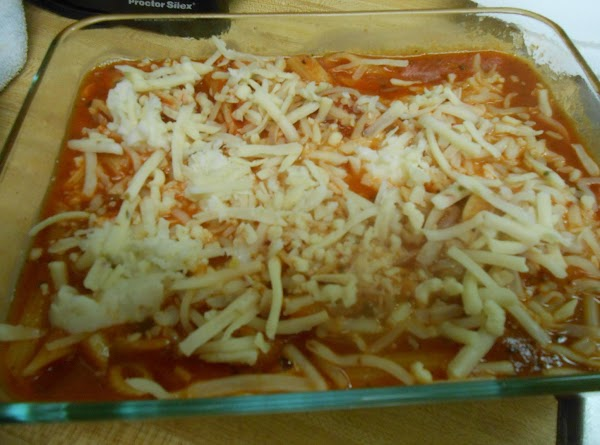 Add the pasta to the sauce mixture and combine thoroughly. Pour into a greased...