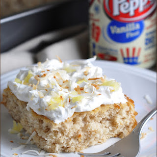 Vanilla Float Cake with Pineapple Whipped Cream and Toasted Coconut.