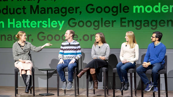Erin sitting on the far left of a panel, pre-COVID, hosting a panel discussion with AI Impact Challenge grantees who received support from Googlers to advance their projects