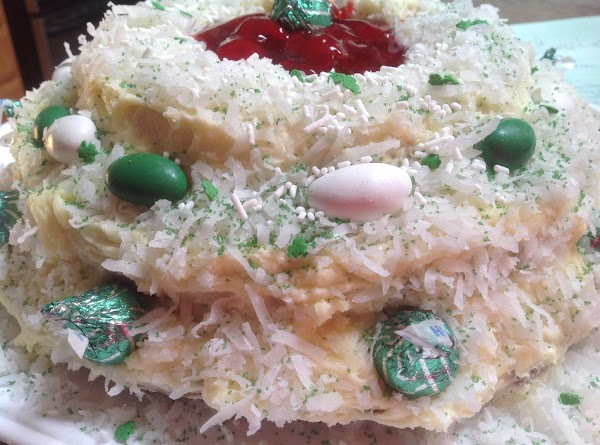 Prepare the frosting by adding all of the ingredients to a medium size bowl,...