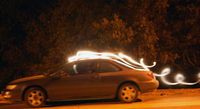 Photo: Requirement 3 (painting with light): With a 20-sec exposure and monstrous MagLite, I tried to produce bright motion streaks, as though the car was moving rapidly downhill. The light streaks (somewhat) represent the airstream as the car passes through.   Added more motion blur to the car via Photoshop, and slightly blurred the light streaks as well.