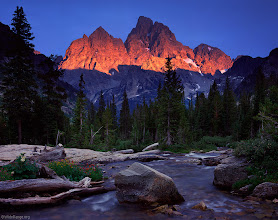 Photo: Brilliant sunset alpenglow light on the Grand Teton, 13,770 feet, and Mount Owen, 12,928 feet, as seen from Cascade Creek to the northwest - July.<br /><br />This was during a three night backpacking loop through Grand Teton National Park.  It had been overcast and drizzling all day long, but I set up my camera anyways just before sunset time, just in case.  Sure enough, I started noticing hints of warmer light on the peaks, and within five minutes, the sun dropped into a gap between the thick cloud cover and horizon, lighting up the peaks like a fiery spotlight.  It was some of the most amazing light I've ever witnessed.