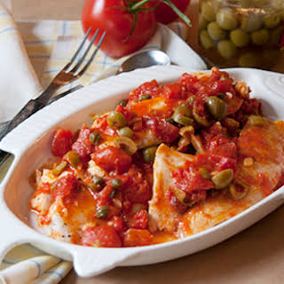 Tilapia with Tomato, Olive & Caper Sauce.