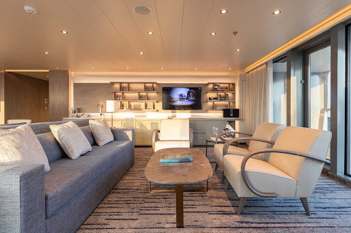 The seating area of the upscale Owners Suite on Silver Origin.