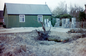 Photo: The Old Tin Hut beside the slab of the new build