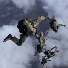 Photo: Pararescuemen from the 38th Rescue Squadron and the 58th Rescue Squadron, Nellis Air Force Base, Nev., jump from a HC-130P/N for a High Altitude Low Opening free fall drop from 12,999 feet in support of Operation Enduring Freedom. PJs use a variety of jumps depending on the mission. / USAF Photograph by Staff Sgt. Jeremy T. Lock.