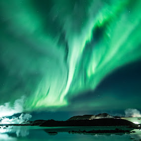 Northern lights by Sigurður Brynjarsson - Landscapes Starscapes ( exposure, dancing, eve, celestial, silhouette, swirl, long, phenomenon, lights, sky, borealis, nature, dark, year, discharge, evening, ionosphere, lagoon, green, aurora, star, atmosphere, astronomy, northern, iceland, new, color, blue, night, magnetic, natural )