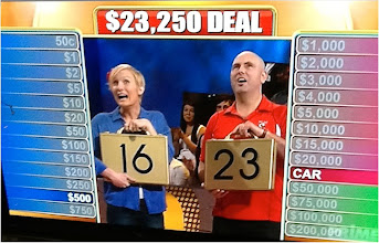 "Photo: Dez (former Saigon President) and Fleur Limbrick win $23,250 on Channel 7's ""Deal or No Deal"" program back in Australia. Dezza wears his Swannies shirts and gives plenty of Swannies' plugs including Swim Vietnam. Fleur announced that she was pregnant. Go you Swannies!! 20 August, 2013."