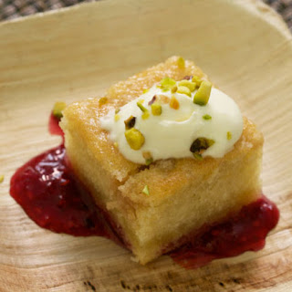 Olive Oil Cake with Raspberry–Lavender Jam, Whipped Crème Fraîche, and Pistachios.