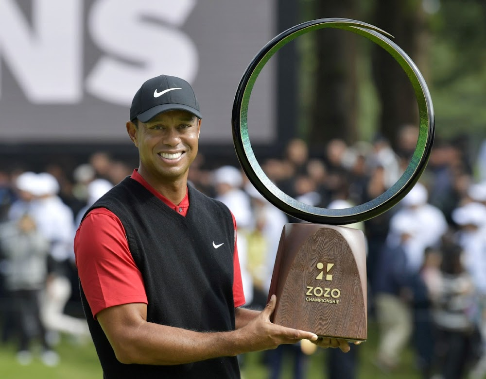 Woods 'never ceases to amaze' as peers tip their hats to greatness