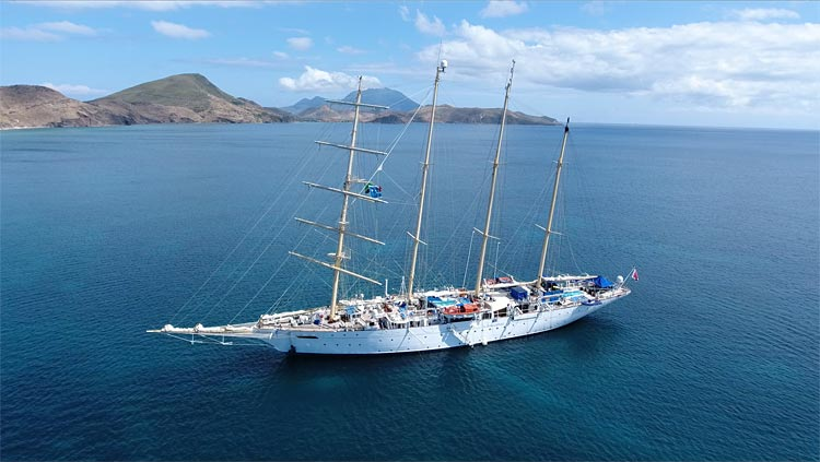 Drone image of Star Flyer from Star Clippers anchored in Frigate Bay, St. Kitts. Are small or large ships a better fit for your travel style?