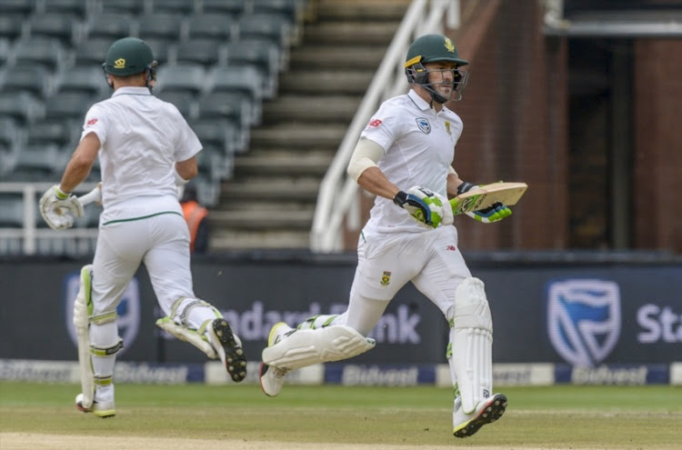 Captain Faf du Plessis and Dean Elgar of South Africa in partnership during day 4 of the 4th Sunfoil Test match between South Africa and Australia at Bidvest Wanderers Stadium on April 02, 2018 in Johannesburg, South Africa.