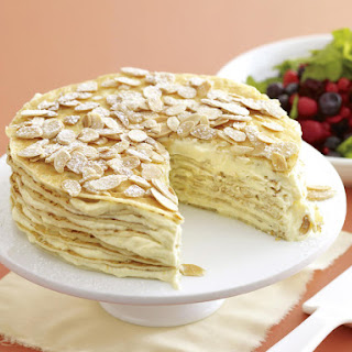 Citrus Crepe Cake with Berry Salad.
