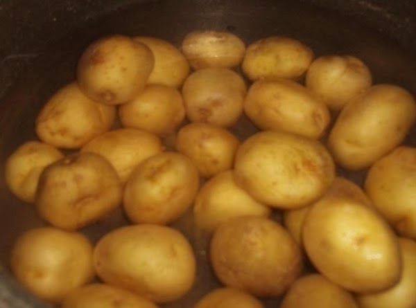 Boil your potatoes in their jackets in salted water until fork tender. Drain to...