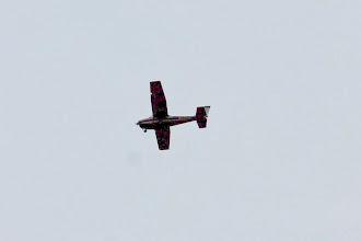 Photo: This airplane flew over and circled the airport.  With the help of zoom, crop, and adding light it looks like N332JC.  It's registered in Delaware... Wonder why!  Uh Duh Huh.