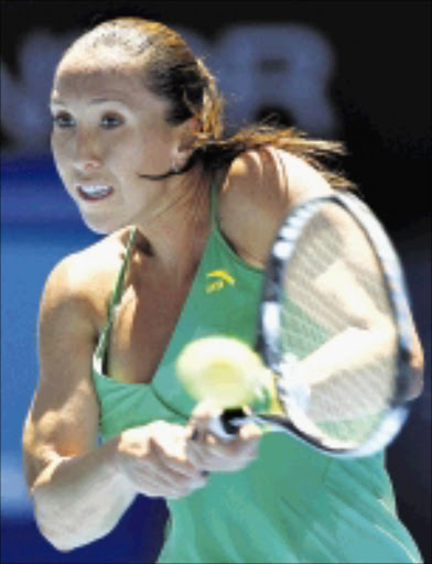 SWEET SPOT: Serbia's Jelena Jankovic returns the ball to Austria's Yvonne Meusburger during thier women's singles match in the Australian Open Tennis Championship in Melbourne, Australia, yesterday. 19/01/2009. Pic. Rick Stevens.  ©AP.