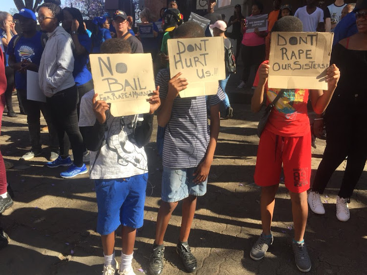 Community members have gathered outside the Pretoria Magistrate's Court where a man accused of raping a young girl in a Dros toilet is expected to appear.