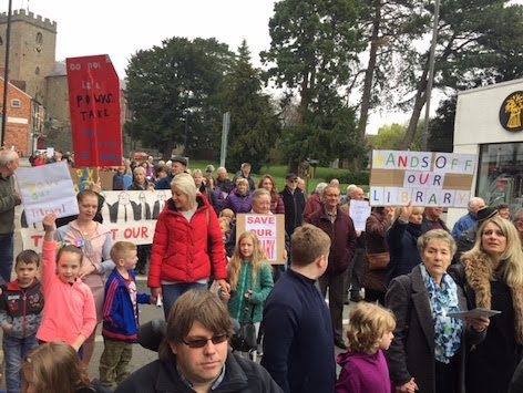 Town unites in protest over library plans