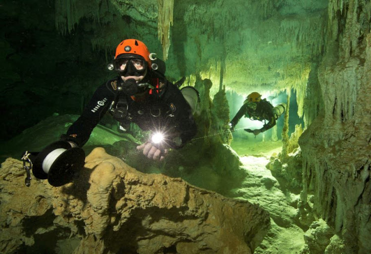 A scuba diver measures the length of Sac Aktun underwater cave system as part of the Gran Acuifero Maya Project near Tulum, in Quintana Roo state, Mexico. File photo