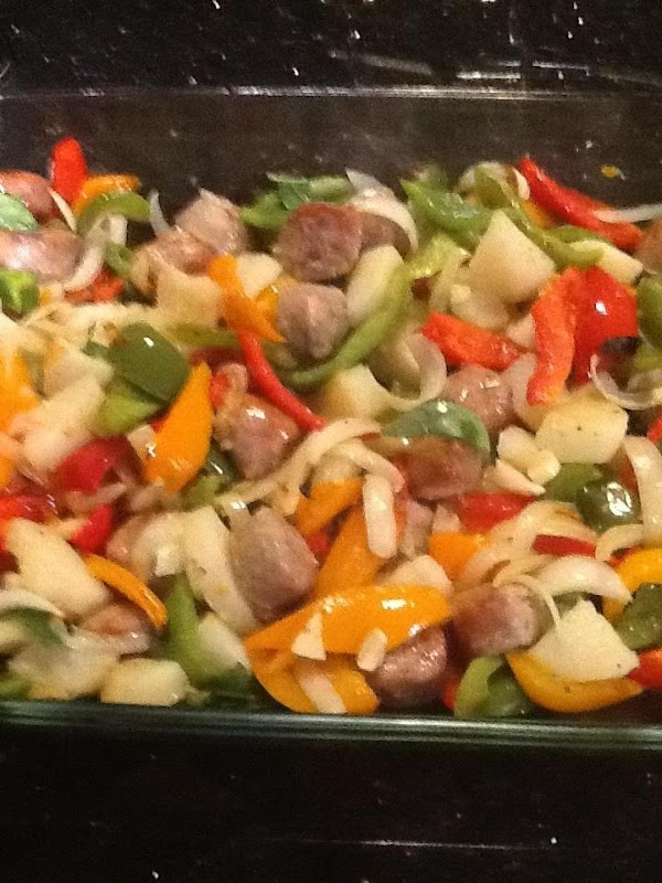 REMOVE BAKN DISH N ADD PEPPERS,ONIONS , GARLIC N BASIL  AT THIS POINT...
