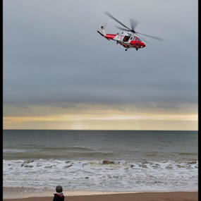 by Alex Newstead - Transportation Helicopters ( helicopter, watch, white, rescue, emergency, sea, hover, bournemouth, lifeguard, red, dorse, boy, amaze )