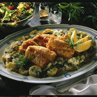 Fried Fish Fillets with Potatoes and Bechamel.