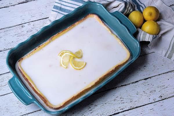 Ice Box Lemon Drop Cake With Glaze On Top.