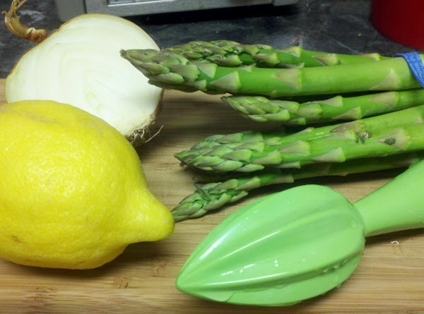 Break woody ends off asparagus and slice diagonally into 1-inch pieces. Peel shrimp if...