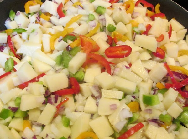 Heat oil and butter over low heat, wash all of the veggies througly, drain...