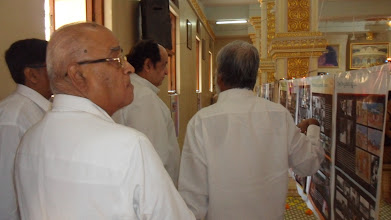 Photo: Dr Pitre viewing the exhibition