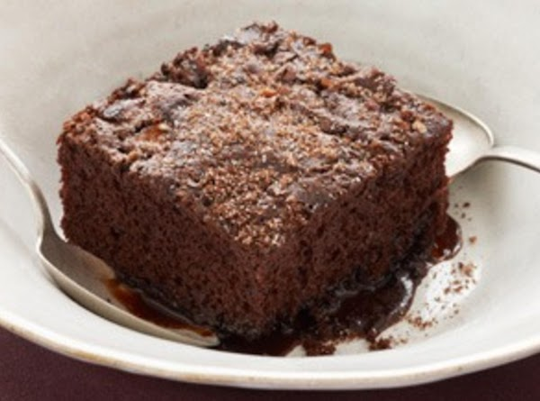 To Serve, Heat Hot Fudge to pouring consistency in water bath or Microwave.Cut cake...