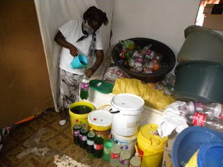 A trader pours detergent into bottles in her house for sale in Nelson Mandela Bay townships.
