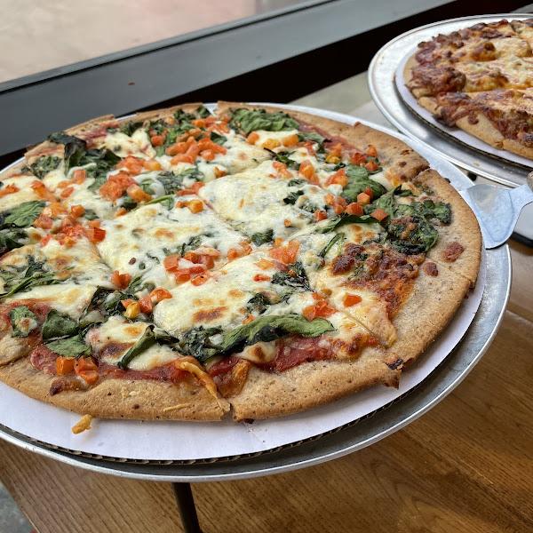GF margherita pizza & GF sausage pizza.