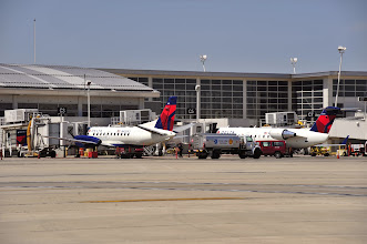 Photo: The McNamara Terminal's 121 gates are all equipped with passenger boarding bridges, meaning Detroit travelers can board and deplane even small commuter aircraft without being exposed to the elements!  CREDIT: Vito Palmisano/Wayne County Airport Authority.
