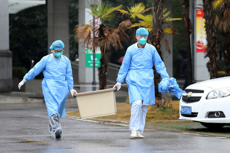 Medical staff carry a box at Jinyintan hospital, where patients with pneumonia caused by the new strain of coronavirus are being treated, in Wuhan, Hubei province, China.
