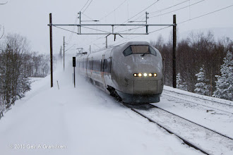 Photo: Flytoget BM71 Airport Express train at high speed through the winter landscape