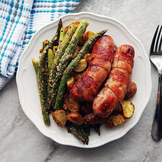 Bacon Wrapped Sausages with Garlic Parmesan Asparagus and Potatoes.
