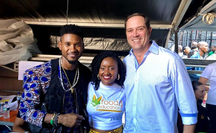 US singer Usher, Wawira Njiru of Kenya and Cisco CEO Chuck Robins at the Mandela 100 Global Citizen Festival in Johannesburg. Picture: CISCO