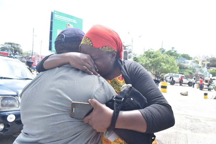 Family members of the victims console each other at the Likoni Ferry crossing channel, Mombasa Island on Monday, September 30, 2019.
