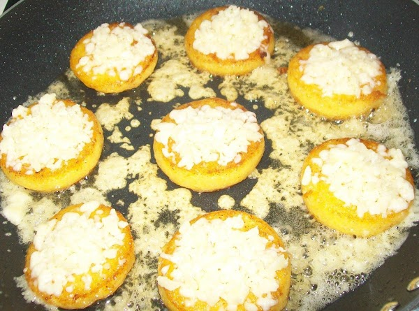 Cover with fresh grated Asiago cheese, continue frying till the other side is browned...