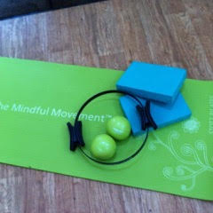 pilates mat on wooden floor in studio
