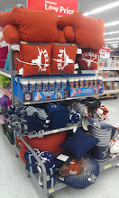 Photo: I NEED one of those lounge pillows with Texas Longhorns on them. This endcap of football gear is right up my alley!!