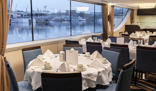 Avalon-Poetry-II-dining-room-window - Have your four-course meal with a view on Avalon Poetry II.