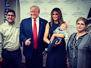 The image of the smiling Donald Trump giving a thumbs-up sign next to a baby orphaned in the El Paso shooting has outraged many.