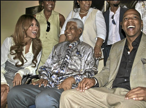 Beyoncé Knowles-Carter with Nelson Mandela and her husband Jay-Z.