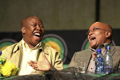 Before the split: President of the ANC Youth League Julius Malema is seen with President Jacob Zuma at a Youth League Congress in this file photograph. When newspapers reported that Malema had secured more than R100m in state contracts, Zuma said it was none of his business. Picture: SYDNEY SESHIBEDI